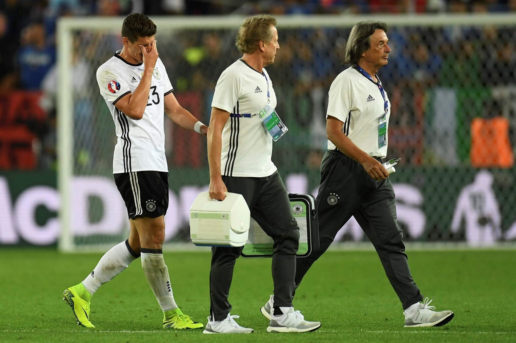 Germany's forward Mario Gomez (L) leaving the pitch during the Euro 2016 quarter-final football match between Germany and Italy at the Matmut Atlantique stadium in Bordeaux on July 2, 2016. (AFP Photo)