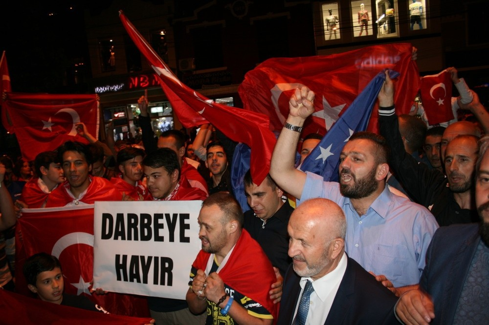 Turks and Albanians in Kosovo stage an anti-coup protest with Turkish flags.
