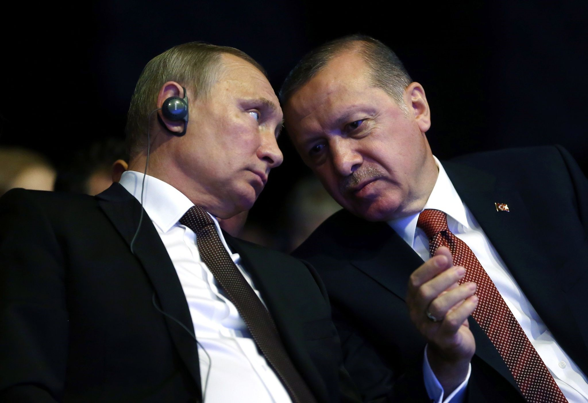 This file photo taken on October 10, 2016 show President Erdogan (R) talking with Putin during the opening ceremony of the 23rd World Energy Congress.