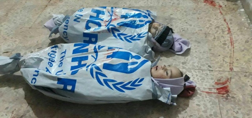 SYRIANS IN EASTERN GHOUTA USE UN BAGS AS SHROUDS TO PROTEST THE AGENCYS INACTION