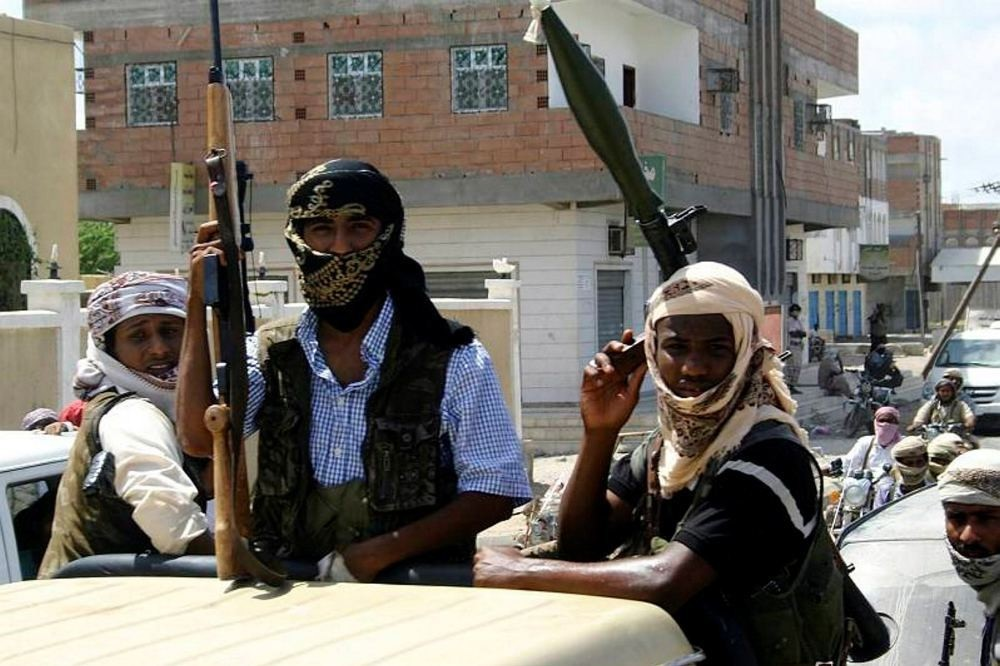 Members of Ansar al-Sharia, an al-Qaida affiliated group, carrying their weapons as they ride in the back of a truck in the southern Yemeni town of Jaar.