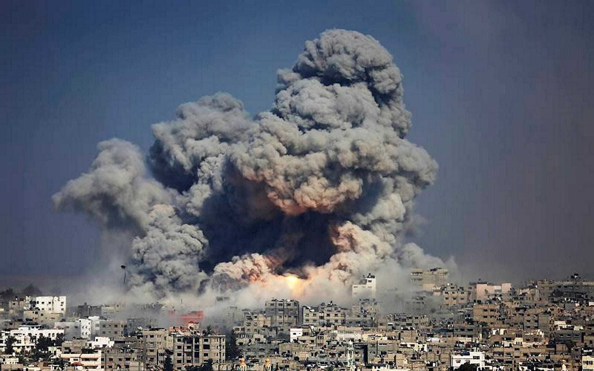 Smoke and fire from an Israeli strike rose over Gaza City on July 29, 2014.