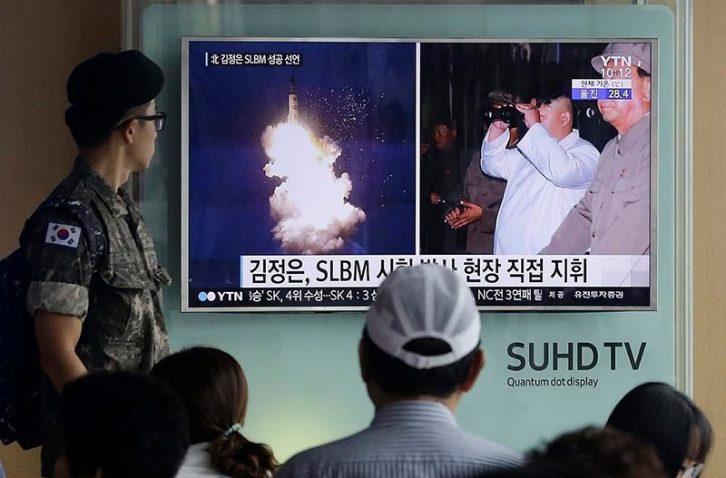 In this Thursday, Aug. 25, 2016, file photo, a South Korean army soldier watches a TV news program showing images published in North Korea's Rodong Sinmun newspaper (AP Photo)