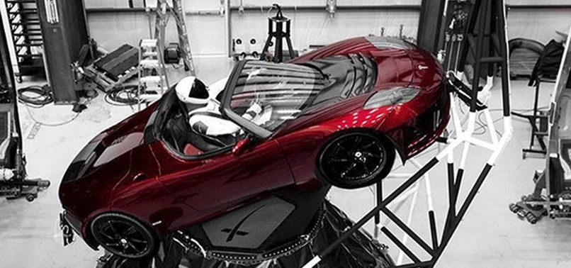 SPACEXS NEW ROCKET TO TAKE OFF WITH SPORTS CAR ON TOP