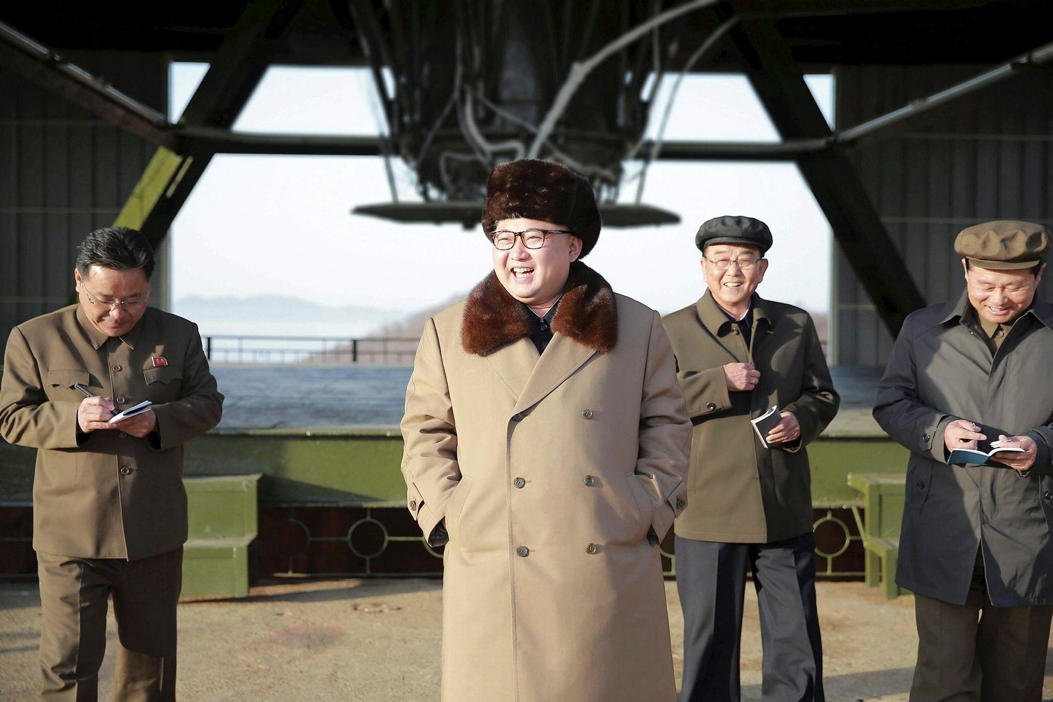 North Korean Supreme Leader Kim Jong Un smiles as he visits Sohae Space Center in Cholsan County, North Pyongan province for the testing of a new engine for an ICBM (KCNA/Reuters)