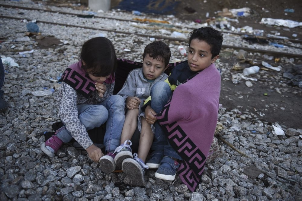 Syrian children as they wait to cross the border from the northern Greek village of Idomeni to southern Macedonia in September 2015.