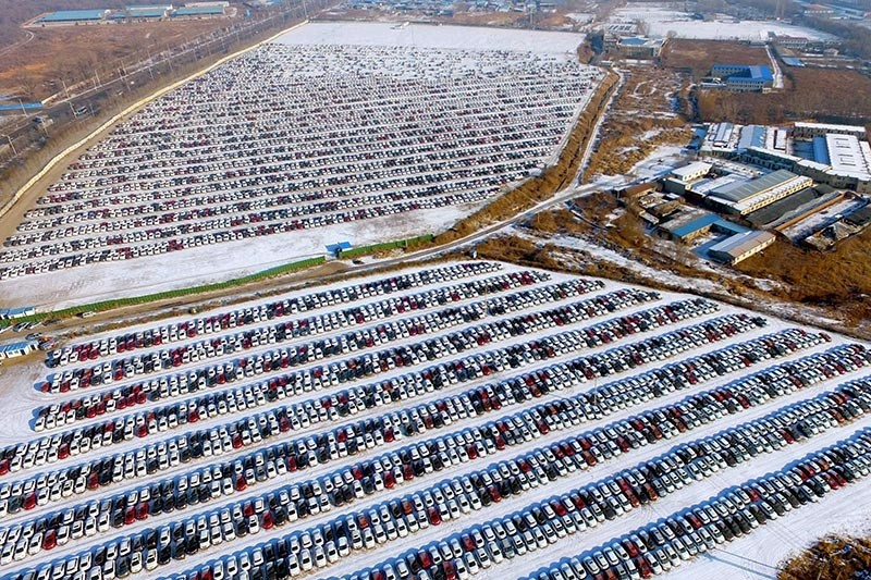 his aerial photo taken on January 16, 2017 shows new cars lined up at a parking lot in Shenyang, northeast China's Liaoning province. (AFP Photo)
