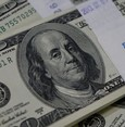 Dollar retreats as Trump takes over; most global stocks fall