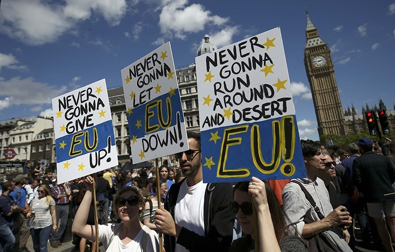 People hold banners during a 'March for Europe' demonstration against Britain's decision to leave the European Union, in central London, Britain July 2, 2016. (REUTERS Photo)