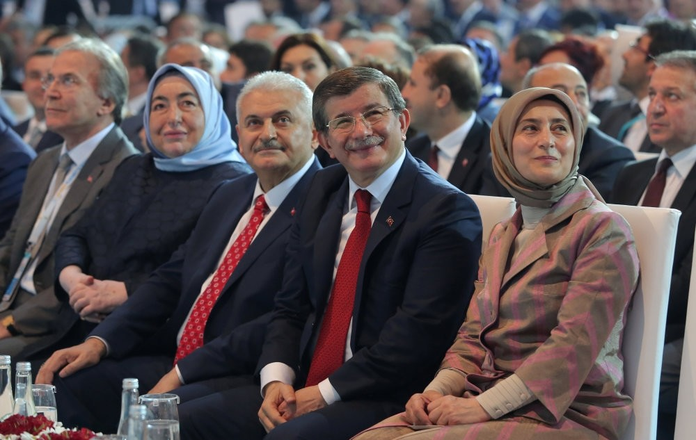 Turkey's PM Binali Yildirim (2nd L) and former PM Davutou011flu (2nd R), accompanied by their wives Semiha Yildirim (L) & Sare Davutou011flu (R), attended the ruling AK Partyu2019s convention in capital Ankara on May 22,2016,  to choose the partyu2019s new leader.
