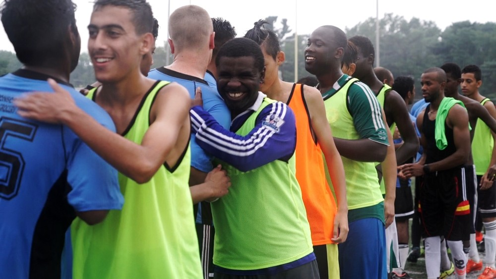 Members of Team Nigeria and Team India shake hands after a friendly soccer match.