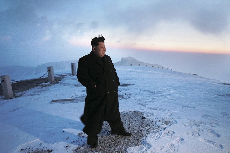 A picture made available on 19 April 2015 by the Korean Central News Agency (KCNA) shows North Korean leader Kim Jong-un posing for a photo on Mount Paekdu, the highest mountain on the Korean Peninsula, April 18, 2015. (EPA Photo)