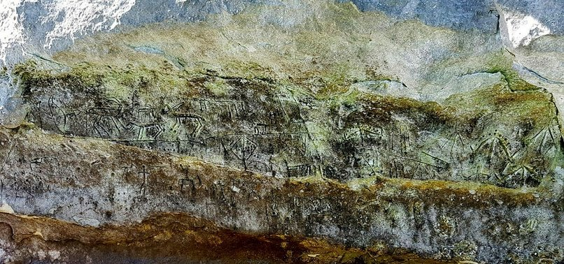 PALEOLITHIC ART UNVEILED AFTER DAM WATER EBBS IN TURKEY