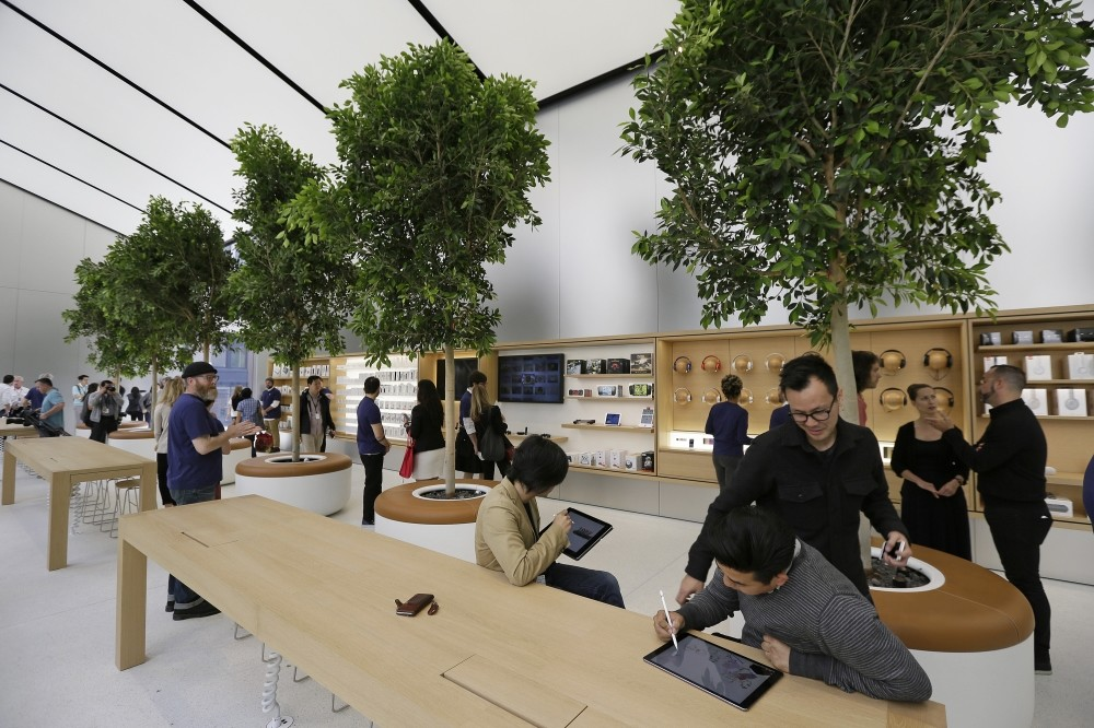 People try products in the u2018Genius Groveu2019 during a preview of the new Apple Union Square Store in San Francisco.