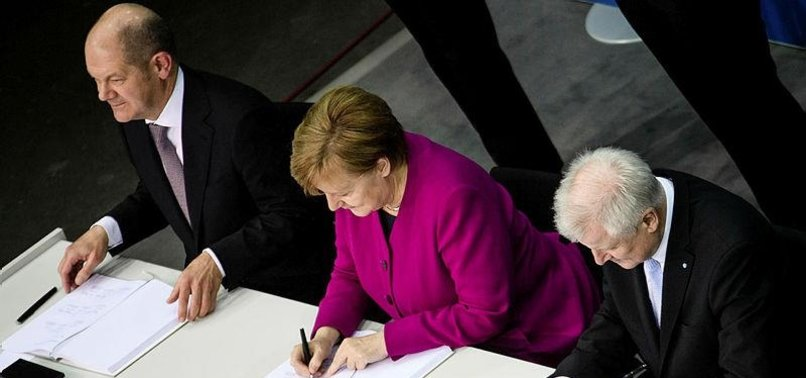 NEW GERMAN COALITION DEAL SIGNED, PAVING WAY FOR MERKELS 4TH TERM