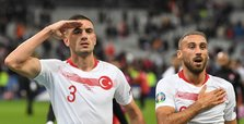 Turkey players celebrate goal against France with military salute