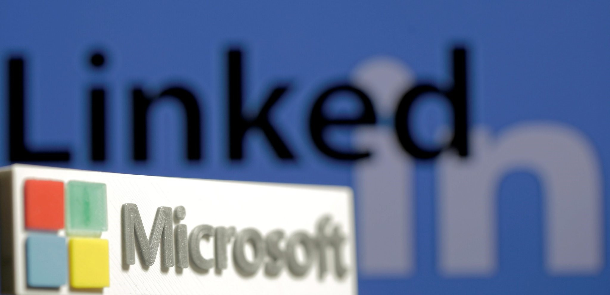 A 3D printed logo of Microsoft is seen in front of a displayed LinkedIn logo in this illustration taken June 13, 2016. (REUTERS Photo)