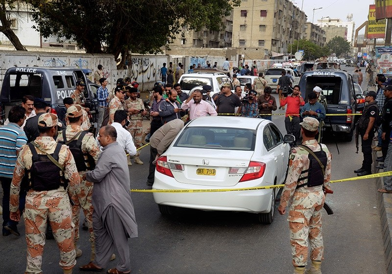 Pakistani investigators and journalists gather around the blood-stained car of famous Sufi singer Amjad Sabri after an attack in Karachi, Pakistan, Wednesday, June 22, 2016. (AP Photo)
