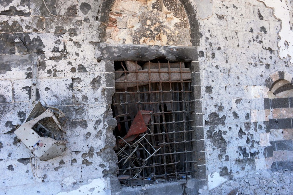This photo shows damaged walls and a broken window of the historical Kuru015funlu Mosque in Sur district of the majority Kurdish southeastern city of Diyarbaku0131r, May 31.