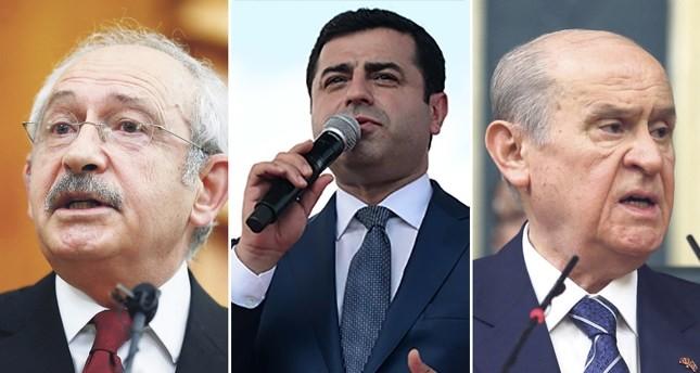 Main opposition CHP chairman Kemal Ku0131lu0131u00e7darou011flu (L), pro-PKK HDP co-chair Selahattin Demirtau015f (C) and nationalist MHP chairman Devlet Bahu00e7eli