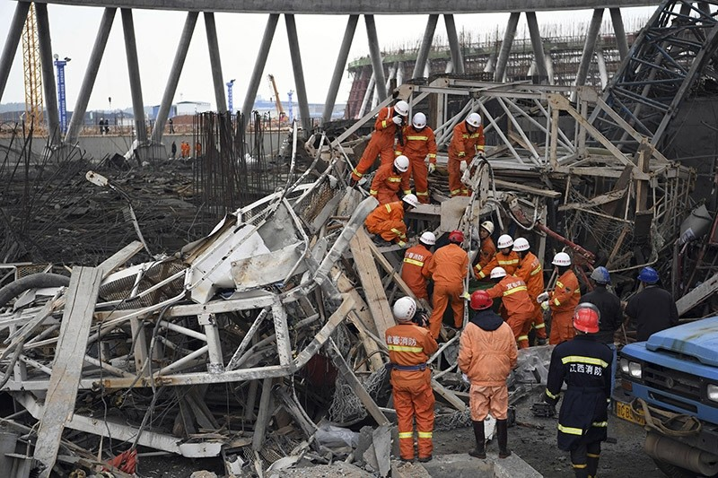 Rescue workers look for survivors after a work platform collapsed at a power plant in eastern China. (AP Photo)