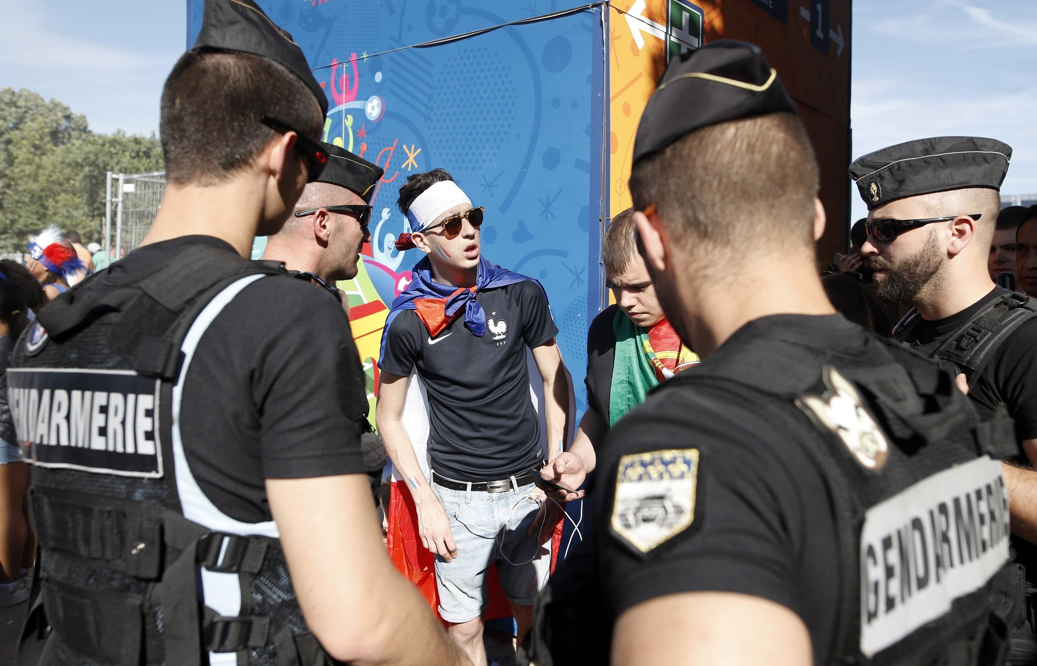French gendarmes check supporters arriving at the Paris fan zone before the Euro 2016 final soccer match between Portugal and France, Sunday, July 10, 2016 in Paris. (AP Photo)