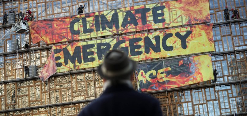 CLIMATE ACTIVISTS PROTEST NEW PLANS AMID EU SUMMIT