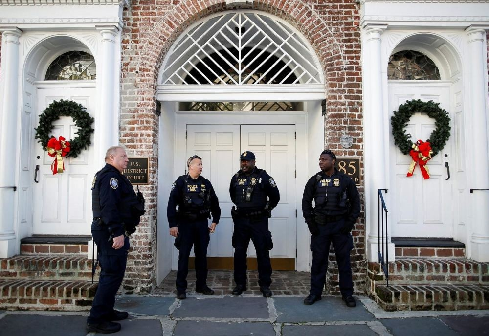 Department of Homeland Security officers stand outside the Charleston Federal Courthouse during the federal trial of Dylann Roof in South Carolina, Dec. 15.