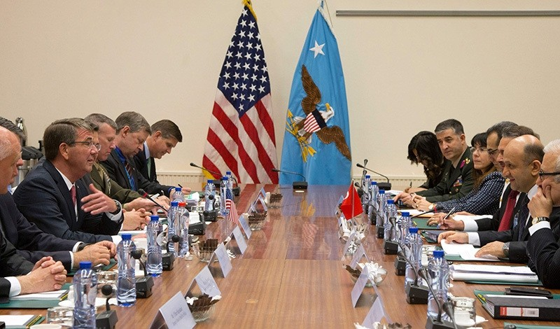 Defense Minister Fikri Iu015fu0131k (2ndR) speaks with US Secretary of Defense Ash Carter (3rdL) during a meeting at NATO headquarters in Brussels on June 14, 2016 (AFP Photo)