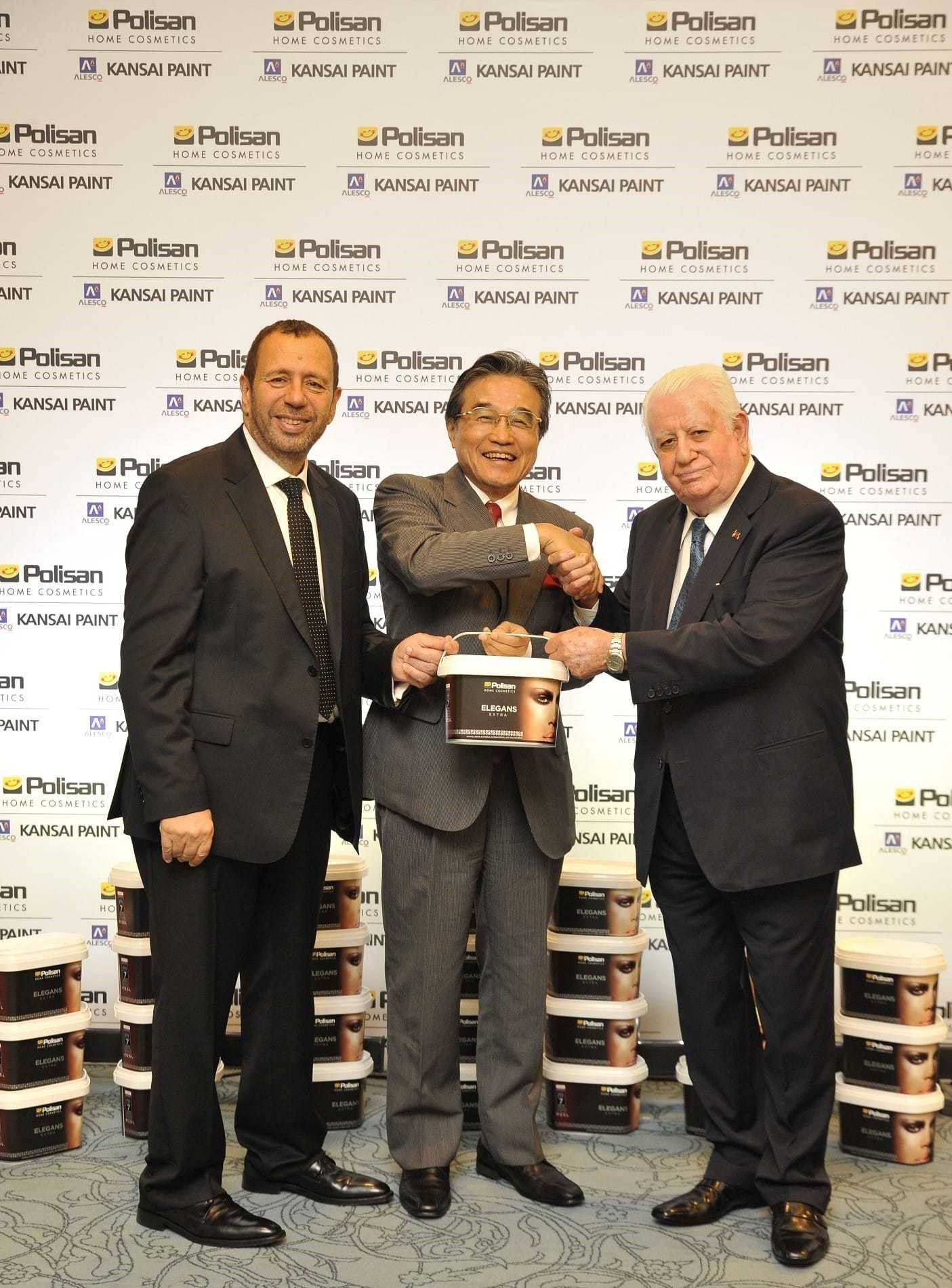 CEO of Polisan Holding Erol Mizrahi (L), Kansai Paint President Hiroshi Ishino (C) and Chairman of the Board of Polisan Holding Necmettin Bitlis (R) celebrates the new deal signed as Kansai Paint took over 50 percent of Polisan shares.
