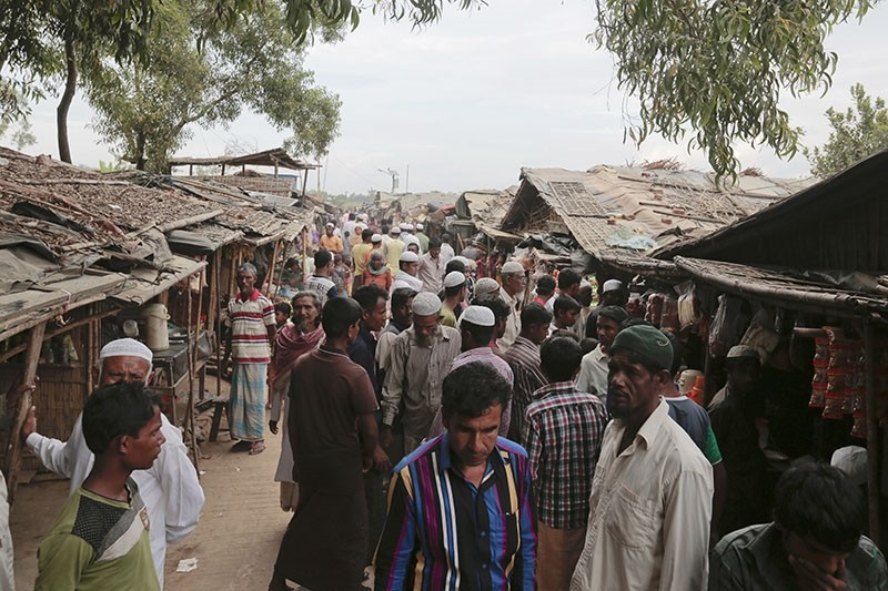 In this Dec. 2, 2016, file photo, Rohingya from Myanmar make their way in an alley at an unregistered refugee camp in Teknaf, Bangladesh. (AP Photo)