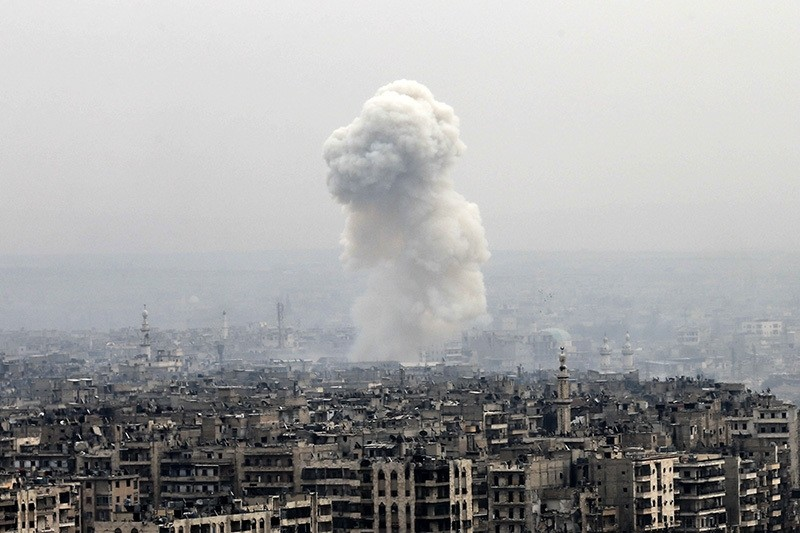Smoke rises following a regime air strike on opposition-controlled neighborhoods, in eastern Aleppo, Syria, Monday, Dec. 5, 2016. (AP Photo)
