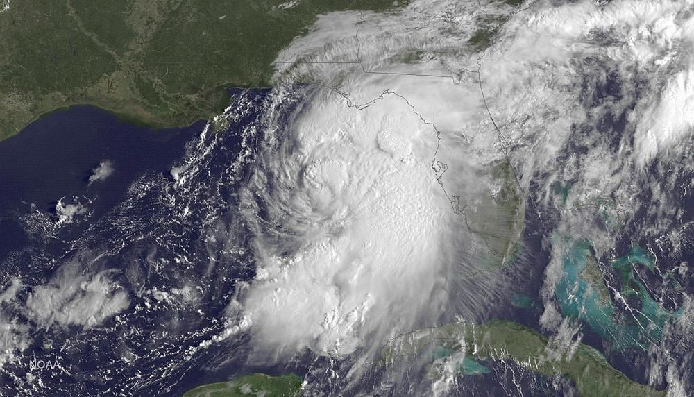 The satellite image taken at 9:15 a.m EDT, on Thursday, Sept. 1, 2016, and release by NOAA shows Tropical Storm Hermine gathering strength in the Gulf of Mexico. (DOAA via AP)
