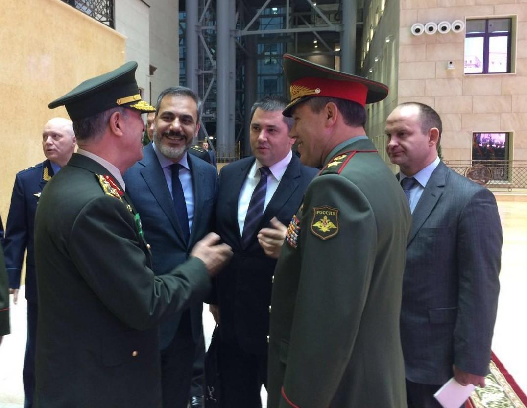 Gen. Hulusi Akar (L) and Gen. Valery Gerasimov (R) and Hakan Fidan (C-L), Head of Turkish National Intelligence Organization (MIT).