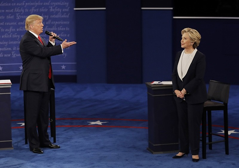 Donald Trump speaks to Hillary Clinton during the second presidential debate at Washington University in St. Louis, Oct. 9, 2016. (AP Photo)