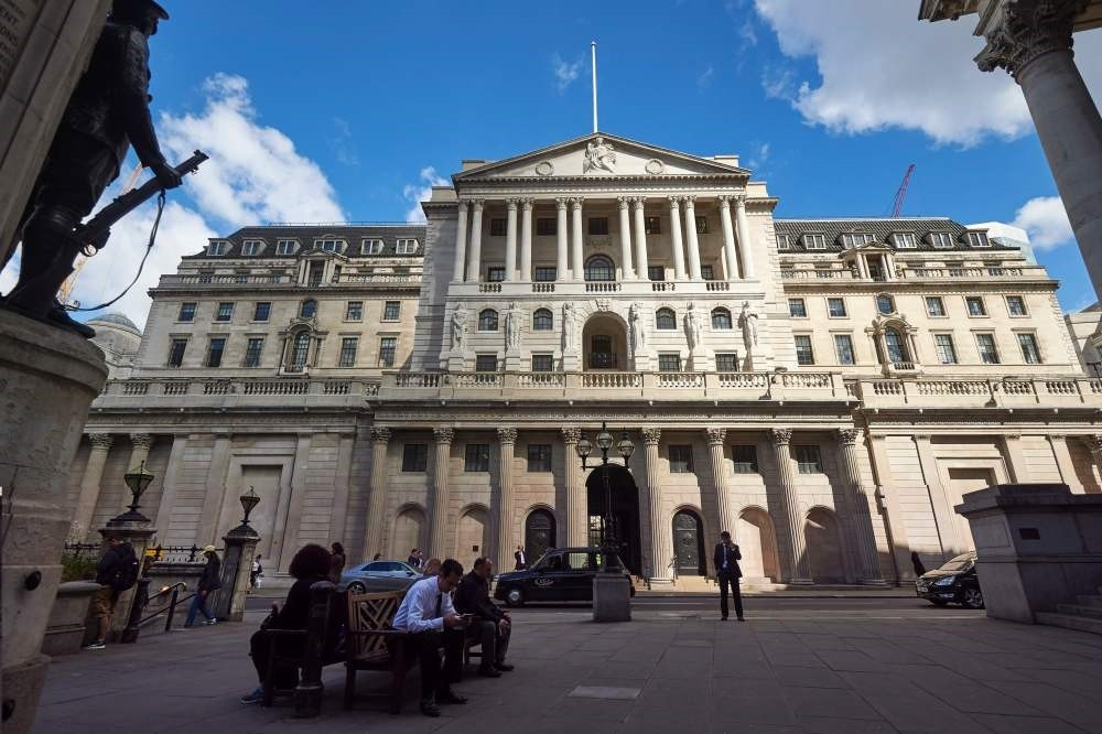 Pedestrians walk past the Bank of England in the City of London on July 14. The Bank of England kept its interest rate at 0.50 percent, but signalled a possible August cut in response to Britain's vote to exit the EU.