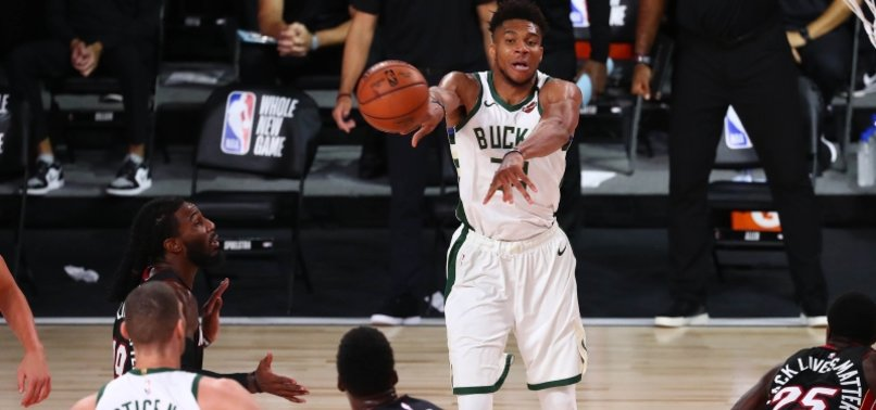 BUCKS DISPATCH HEAT TO CLINCH TOP SEED IN EAST