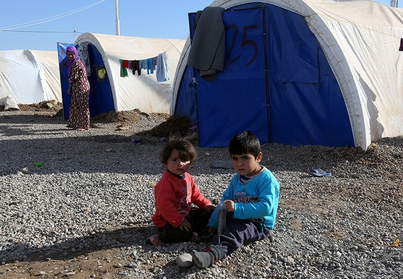 Iraqi displaced children from Mosul sit on the ground near the tents at Khazir camp, east of Mosul, northern Iraq, 04 December 2016 (EPA Photo)