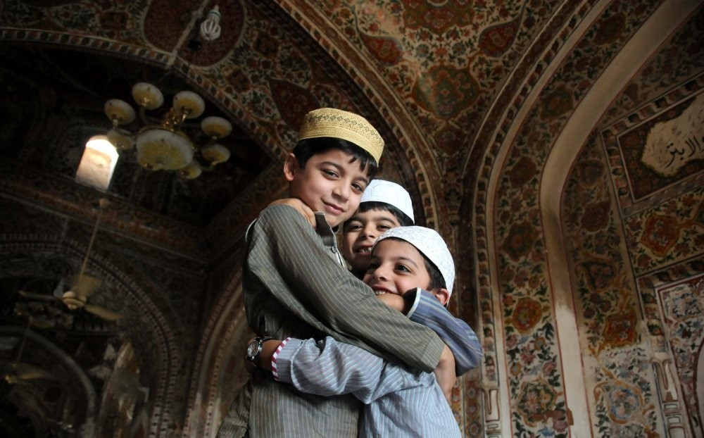Children greet each other after offering bayram prayers at a mosque.