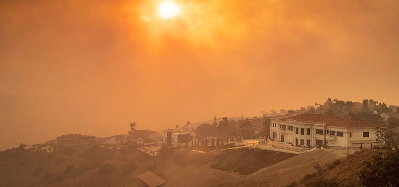 US: CALIFORNIA FIRES FORCE 100,000 TO EVACUATE