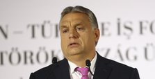 Hungary tightens restrictions as virus cases surge