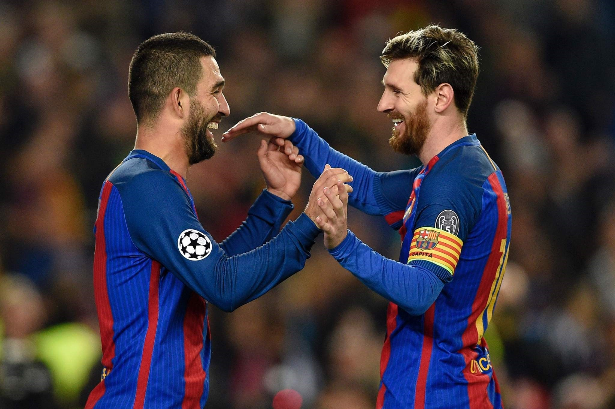Barcelona's Turkish forward Arda Turan (L) celebrates with Messi after scoring during the UEFA Champions League Group C football match. (AFP Photo)