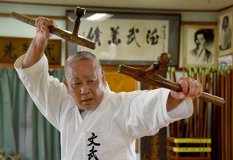Karate master Takashi Nakamori, a high-ranking expert of the Okinawa Kobudo traditional weapons system, using a pair of ,tonfa, to demonstrate his skills at a training hall in Naha, Okinawa prefecture, June 18, 2016. (AFP Photo)
