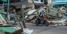 Indonesian island hit by another quake, causing landslides