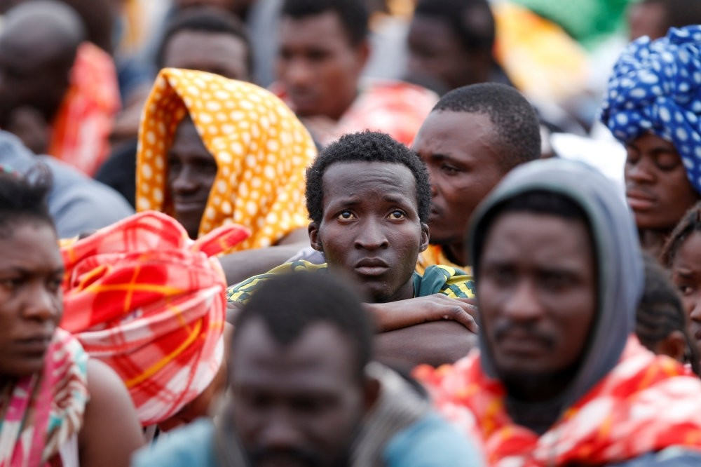 Migrants disembark from a vessel in the Sicilian harbour of Augusta, Italy, June 24.