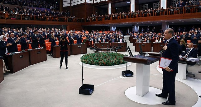 President Erdou011fan approaches to the rostrum at the Parliament to make his address for the first session of the new legislative year. (AA Photo)