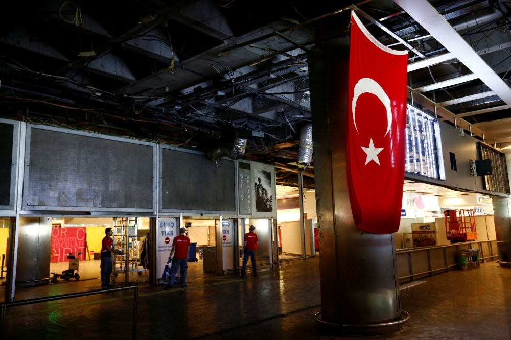 Workers repairing the damaged sections of the terminal building at Turkey's largest airport, Istanbul International Atatu00fcrk Airport, following the explosions on Tuesday, June 29, 2016.