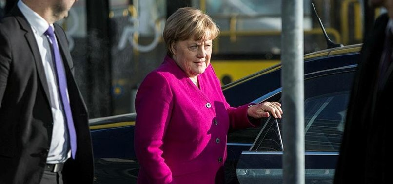 GERMAN CHANCELLOR URGES COMPROMISE IN COALITION TALKS