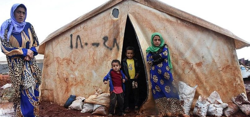 REFUGEES IN SYRIA'S IDLIB STRUGGLE WITH RAINS, FLOODING