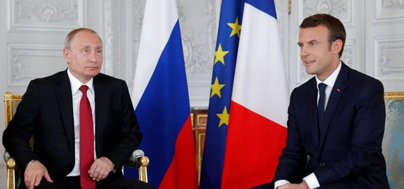 MACRON SAYS HE IS 'THE EQUAL' TO RUSSIAS PUTIN